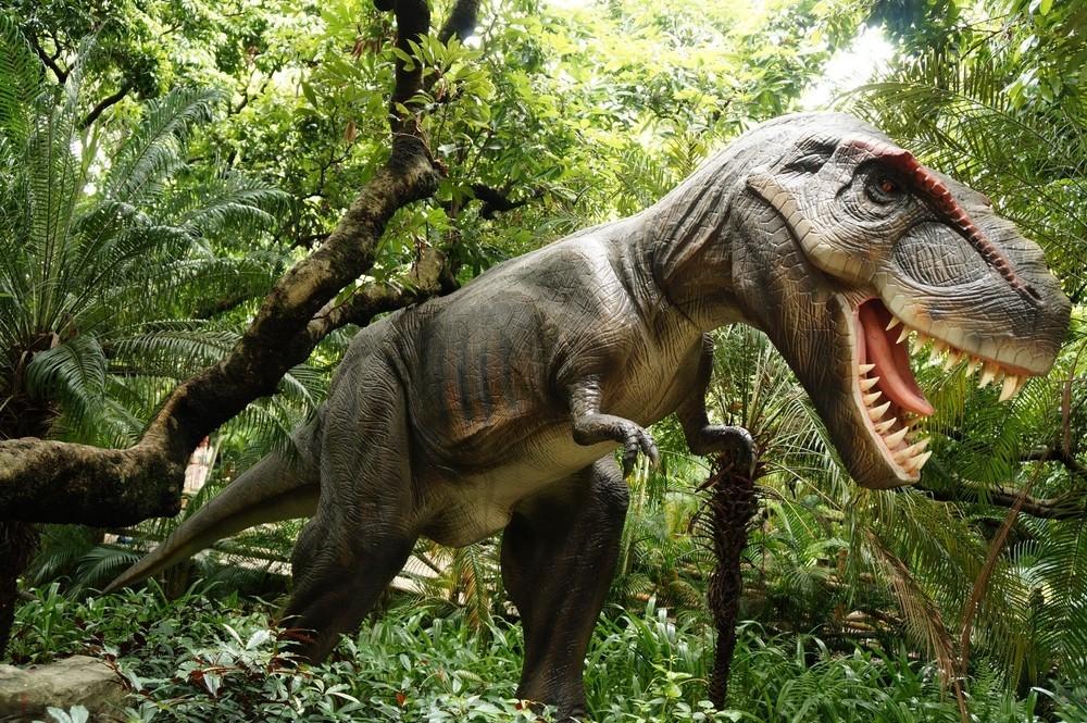 手绘绿色凶猛大恐龙